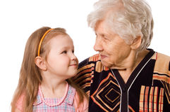 The elderly woman with the grand daughter Royalty Free Stock Photography