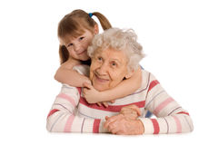 The elderly woman with the grand daughter Royalty Free Stock Images