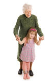 The elderly woman with the grand daughter Stock Photography