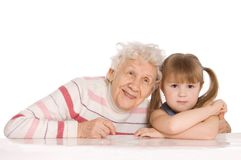 Elderly woman with the grand daughter Royalty Free Stock Photos