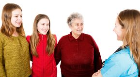 Elderly woman with granddaugthers and young doctor. Photo of elderly women with granddaugthers and young doctor Stock Photography