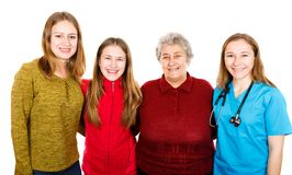 Elderly woman with granddaugthers and young doctor. Photo of elderly women with granddaugthers and young doctor Stock Photo