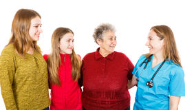 Elderly woman with granddaugthers and young doctor Royalty Free Stock Image