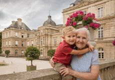 Elderly woman with grandson. Outdoor portrait of Elderly women with her grandson in the Luxembourg Gardens royalty free stock image