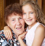 Elderly woman with great-grandchild Stock Photo