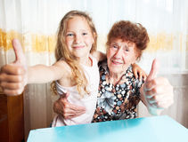 Elderly woman with great-grandchild Stock Image