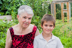 The elderly woman with the great-grandson on the nature Royalty Free Stock Photography