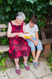The elderly woman with the great-grandson read the book Royalty Free Stock Images