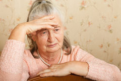 Elderly woman grieves at home. Royalty Free Stock Photos