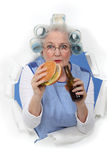 Elderly woman with hair rollers Stock Photography