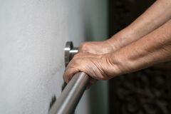 Elderly woman hand holding on handrail for walking. Elderly woman hand holding on handrail for support walking Stock Photos