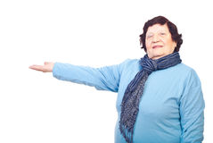 Elderly woman with hand outstretched stock image