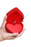 Elderly woman hands holding an open red heart box Royalty Free Stock Image