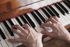 Elderly woman hands playing the piano, close up stock images