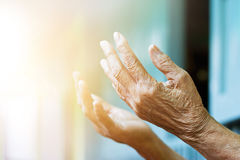 Elderly woman hands praying with peace of mind and faithfully Royalty Free Stock Photos