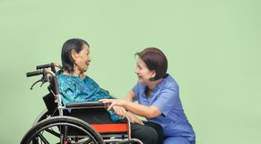 Elderly woman happiness talking with caregiver royalty free stock images