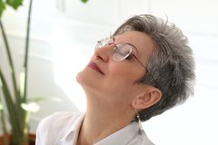 Elderly woman with happy face Royalty Free Stock Images