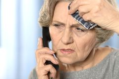 Elderly woman has flu Royalty Free Stock Photography
