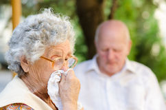 Elderly woman has flu stock photos