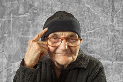 Elderly woman has an idea. Stock Photo