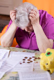 Elderly woman has need of money Royalty Free Stock Photo