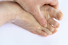 Elderly woman has pain in the feet and toes Stock Photography