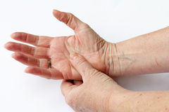 Elderly woman has pain in his hands Royalty Free Stock Image