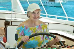 Elderly woman have a ride in a boat Royalty Free Stock Images