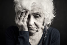 Elderly woman having a dsepression Royalty Free Stock Photos