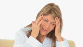 Elderly woman having a huge headache