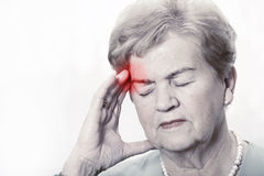 Elderly woman with a headache stock photo
