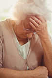 Elderly woman with headache Royalty Free Stock Images