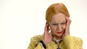 Elderly woman with headache isolated. stock video footage