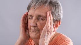 Elderly woman with headache Stock Photography