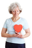 Elderly woman with healthy heart royalty free stock photo