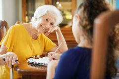 Elderly Woman Helping Little Girl Doing School Homework Royalty Free Stock Photography