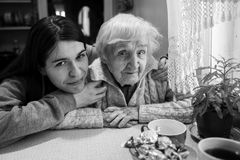 Elderly woman with her adult granddaughter. royalty free stock photo