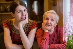 Elderly woman with her adult granddaughter. Royalty Free Stock Photos
