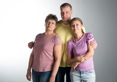 Elderly woman with her adult son and daughter. Elderly women with her adult son and daughter in the studio stock photos