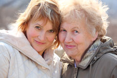 Elderly woman and her daughter royalty free stock photo