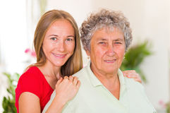 Elderly woman and her daughter Royalty Free Stock Images