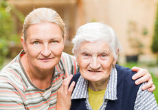 Elderly woman with her daughter Royalty Free Stock Image