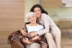 Elderly woman and her daughter sitting Stock Photos