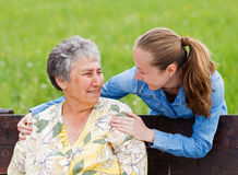 Elderly woman and her daughter Stock Photography