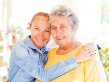 Elderly woman and her daughter Stock Image