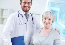 Elderly woman and her doctor Stock Images