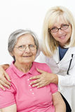 Elderly woman  with her female doctor Royalty Free Stock Image