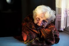Elderly woman in her house. Ð¡are of seniors stock images