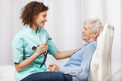 Elderly woman and her nurse Stock Images