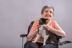 Elderly woman with her pet Stock Image